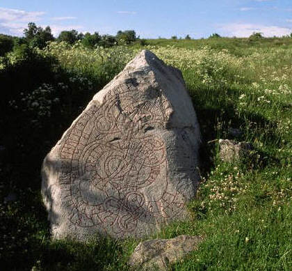 A rune stone in the garden of an ancient temple, Sweden